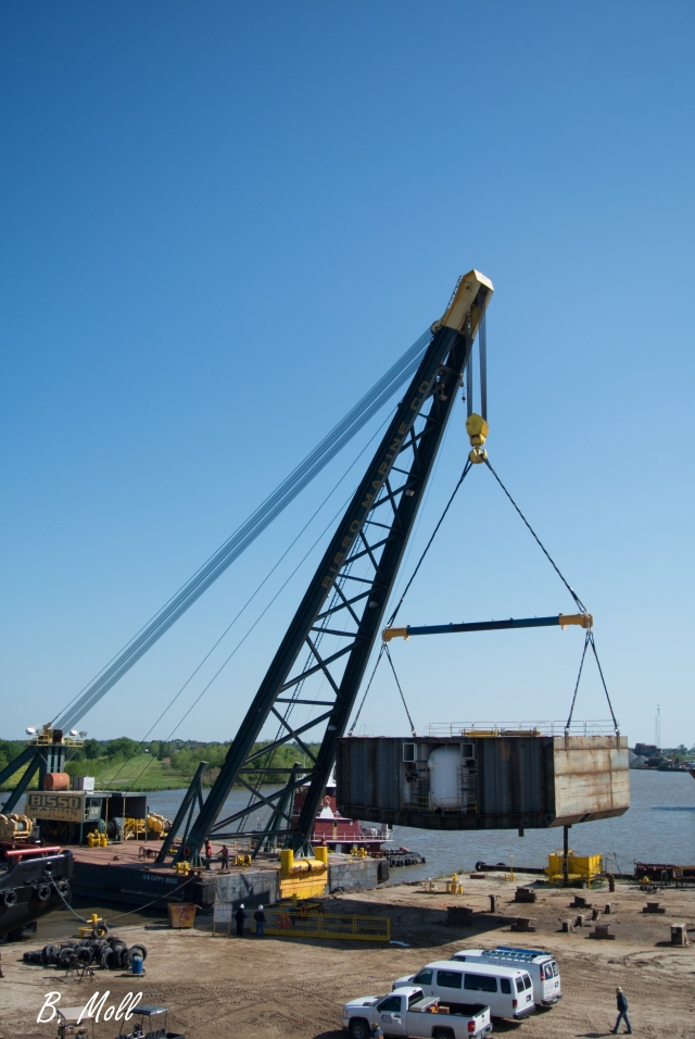 Bisso derrick barge lifting a mid section plug for the Odyssea boat in the dry dock