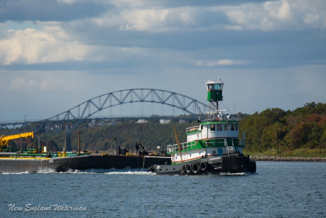 Quenames eastbound with a loaded barge
